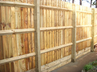 Close board fencing with wooden posts